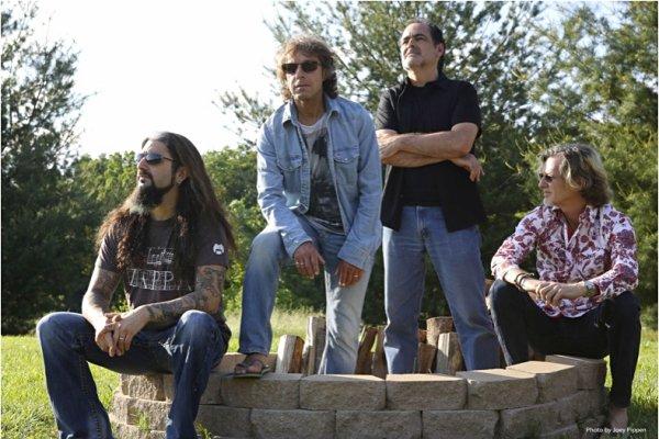 The band in nature (L to R: Portnoy, Trewavas, Morse, Stolt)
